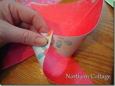 How to make a pinwheel: 12 x 12 double-sided scrapbook paper into 4 squares 6 x 6 each; Fold each into a triangle; Cut from the pointy end of that triangle to about an inch from the folded line; Repeat for the other side by opening & refolding it the other way; (Do not cut center); Punch a whole in each corner; Place brads into the TOP of the first punched whole, put the next corner on the brad, and continue around; Not too tight so it will turn. Attach to ribbon on package.