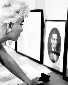 Marilyn Monroe studies a portrait of her idol, Abraham Lincoln, in Bement, Illinois, 1955.