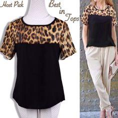 Leopard Chiffon Blouse Short sleeve leopard chiffon blouse. Top part leopard and bottom black. New! Boutique Tops Blouses