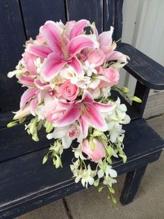 Cascading Stargazer lily, pink rose, stephanotis, and white orchid bouquet. Stargazer Lily Bouquet, White Orchid Bouquet, Stargazer Lily Wedding, Lily Bouquet Wedding, Bride Bouquets, Floral Wedding, Wedding Flowers, Tiger Lily Bouquet, Rose And Lily Bouquet