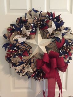 This Americana Wreath is made of ivory and cotton burlap deco mesh. In the center is an ivory metal star. The wreath is accented throughout with burlap and cotton ribbon in the colors of navy blue, ivory and burgundy. A burgundy bow with long tails was attached. I then accented it with ivory pip berries and rusty stars. Pip berries are recommended for indoor use. Show your patriotic pride in the Fourth of July, Memorial Day, Veterans Day, Presidents Day, Labor Day or anytime of the year…