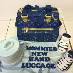 Louis Vuitton baby diaper bag baby shower cake.  Blue and gold.