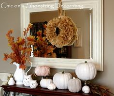 This site is full of inexpensive  decorations for the fall season ...Some paint, flea market picture frame, a few white pumpkins ... Grab some fall leaf branches, & you have something cool....