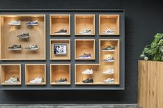 A Look Inside Antwerp's Sneaker District Store: With an interior referencing sneaker design and the local neighborhood. Boutique Interior, Clothing Store Interior, Showroom Interior Design, Clothing Store Design, Shoe Boutique, Shoe Display, Display Design, Design Shop, Shoe Store Design
