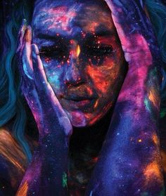 Girl wearing face paint with space art