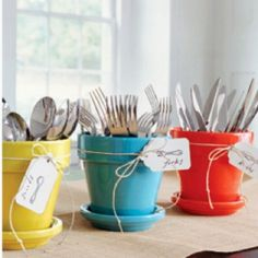 This is the idea I thought of for storing silverware in our house!  Super great, space saving, and cute! :)