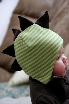 An absolutely adorable fleece hat! Winter Dino Hat with tutorial. I think this with the tab dinosaur plush (http://www.bubblesandbobbins.com/2012/03/tutorial-how-to-make-dinosaur.html) would make for a great start to a themed box for 2-4 yo boy! (A sometimes hard box to fill.)