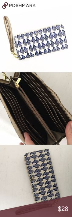 """Fossil Navy Penguins Leather Wristlet Wallet Leather. Gently pre-loved with very minimal wear. Please see all pictures for an accurate description of condition. Approx. 8"""" by 4"""". *0606170200* Fossil Bags Wallets"""