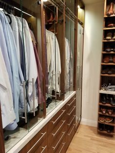 Oiled Walnut cabinetry,lighting activated by glass doors tall shoe cubbie and stone top Building Design, Building A House, Construction Group, Glass Doors, New Homes, Shoe, Lighting, Closet, Home Decor