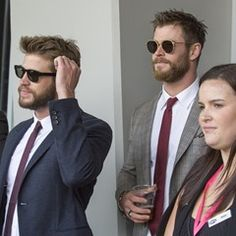 EXCLUSIVE The Hemsworth brothers suit up at the AFL Grand Final