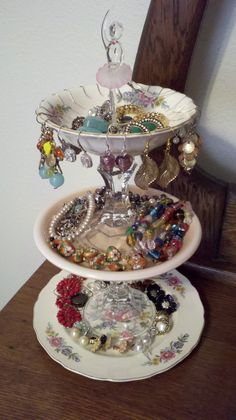 Pretty plates, candle holders, hot glue together and you have a cute jewelry stand. As of Lately