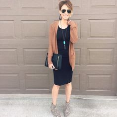 Brown sweater with black dress and leopard booties, perfect for the fall season.