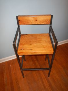 This is my Industrial Vintage Style Barstool. I craft each piece of furniture by hand. Stool seat is 30 high 19 wide. I handcraft each Bar Stool from welded steel square tubing with reclaimed floor joists for the seat and the back. I accented all the character of the reclaimed wood, nail holes and the holes where the knob and tube electric wires once were. The seat is attached to the metal frame with 1/2 bolts which are exposed on the side to give the piece that industrial feel. The st...