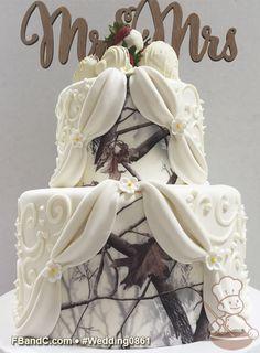 "Design W 0861 | Fondant Wedding Cake | 9""+6"" | Serves 40 | White Buttercream Scrolls, White Fondant Drapes, Peek-a-boo Camo | Custom Quote"