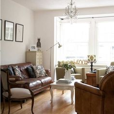 Brown leather sofa with white coffee table. I don't love this room but want to do something similar, since we have a brown leather sofa but I want to switch to a modern shabby chic without buying a new sofa or slipcover.