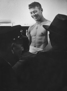 Mark Kauffman—Time & Life Pictures/Getty Images -- Twenty-year-old Mickey Mantle celebrates in the locker room after a Yankees' World Series win, October 1952. The Yankees beat the Dodgers in seven games that year to claim the title.