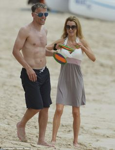 Phil Neville hits the beach with wife Julie in Barbados