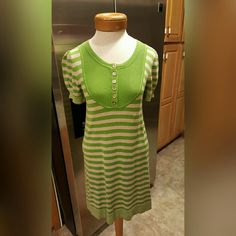 Juicy Couture Sweater Dress Size Small Juicy Couture Sweater Dress Size Small This dress is NWOT  My daughter never wore it.  Her loss because it is just beautiful.   Gorgeous green & tan.  Gold buttons adorn the front.  100% cotton.   Feel free to ask any questions before purchasing. Thanks for shopping my closet! Juicy Couture Dresses
