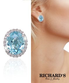 Oval Blue Topaz and Diamond Halo Earrings in 14K White Gold