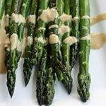 I usually eat asparagus with just a little butter spray. This sounds like a good way to dress it up!