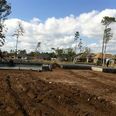 Lake views. Building solid foundation. New home construction site in development. #GrandeDunes