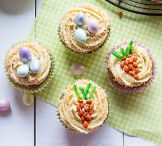 Easter themed Carrot Cupcakes with Maple Cream Cheese Frosting. Sprinkled with coconut to look like nests and decorated with candy eggs and carrots. Carrot Cupcake Recipe, Cupcake Recipes, Cupcake Cakes, Dessert Recipes, Desserts Ostern, Fun Desserts, Easter Desserts, Holiday Desserts, Easter Traditions