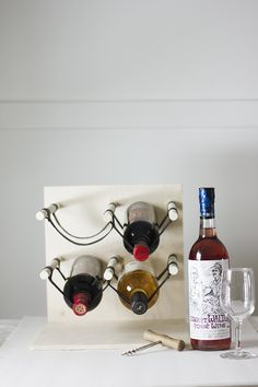 DIY: wood and leather wine rack