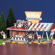 "Department Products - ""Gus's Drive-In"" - View Lighted Buildings retired Disney Christmas Village, Department 56 Christmas Village, Dept 56 Snow Village, Christmas Villages, Winter Christmas, Christmas Home, Villas, Christmas Cookie Jars, Light Building"