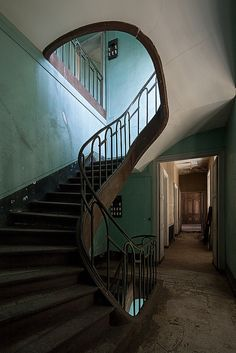 Stairs in an abandoned mansion in France, by Le Luxographe