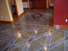 Great geometric shapes on this engraved concrete floor. Stain color choice is excellent.