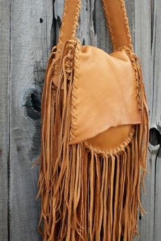 This fringed leather bag is made from saddle elkskin leather. This leather bag has an extra pocket inside. #bohobags