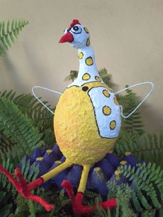This is a sculpture made of paper mache, sitting in an egg case. Paper Mache Projects, Recycled Art Projects, Paper Mache Crafts, Recycling Projects, Gourd Crafts, Art For Kids, Crafts For Kids, Arts And Crafts, Diy Crafts