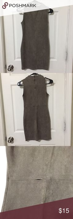 Grey Faux Suede Body-con Dress Grey faux suede dress. Damaged on the back area. Easy fix- just needs to be re-sewn.  92% Polyester 8% Spandex Dresses Mini