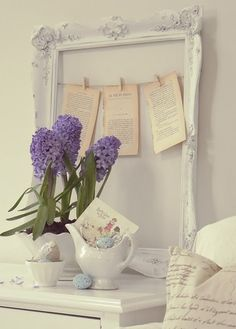 love the color from the hyacinths framed by the chippy frame