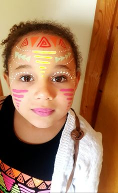 Aztec face painting. Tribal face painting. Can be used for adults or children. My daughter wanted her face paint to match her top. It was quick easy and fun. Festival face painting. Face painting by chantelle hallett.