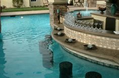 Luxury outdoor Kitchen with swim up bar Designs | ... style backyard with this amazing swim up bar won a design award