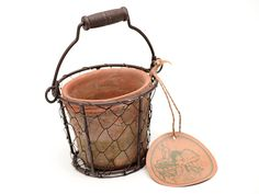 GNW Aged Terracotta Pot In Wire Basket With Handle