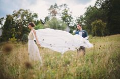 Formal Barn Wedding, Bride and Groom shoot. Custom dress and cape veil by Kathryn Conover.  Photography: Divine Light Photography - dlweddings.com @Divine Light Photography   Read More: http://www.stylemepretty.com/tri-state-weddings/2014/02/25/diy-formal-wedding-at-rufflands-farm/