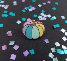 "Show off your Halloween spirit year-round with this sweet little rainbow pumpkin pin! - Hard enamel - 1"" wide - High polished copper plating - Single post & rubber cap - Limited edition of 150"