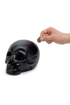 Far more stylish than my plastic bucket that I use to keep change in now! Kikkerland Coin Bank Skull