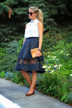 A white sleeveless button down shirt and a black mesh full skirt are a great outfit formula to have in your arsenal. Elevate your getup with brown leopard suede ballerina shoes.   Shop this look on Lookastic: https://lookastic.com/women/looks/sleeveless-button-down-shirt-full-skirt-ballerina-shoes/15183   — Black Sunglasses  — White Sleeveless Button Down Shirt  — Black Mesh Full Skirt  — Tan Leather Clutch  — Brown Leopard Suede Ballerina Shoes