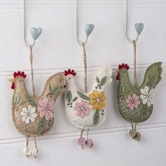 Hens, hearts, birds done in embroidered colours.Original folk art? Mexican? We are loving them.