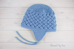 Stay extra bundled and warm this fall and winter with the Celtic Dream Earflap Crochet Hat. This intermediate crochet hat pattern features a striking slanted basketweave-like crochet stitch pattern that stands out among all other designs. Crochet Kids Hats, All Free Crochet, Crochet Mittens, Knitted Hats, Crochet Beanie Pattern, Crochet Cap, Crochet Stitches Patterns, Hat Patterns, Stitch Patterns