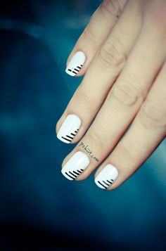 Nail Art - Nail Polish.  White with black stripes.