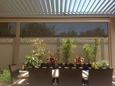 Aluminium framed Louvre roof with patio blinds. Project fit's in with tight backyard space where ensuing good light plus controlling shade a must. Blinds ensure breeze free lounging.