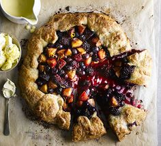 Fill homemade rough puff pastry with a medley of soft juicy blackberries, blueberries and plums for an easy and eye-catching dessert