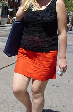 Love a woman's miniskirt horizontally wrinkled down to it's bottom hem. Want to see her sit down to see how she wrinkles the front of her miniskirt so much!