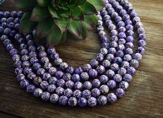 Hey, I found this really awesome Etsy listing at https://www.etsy.com/listing/185036955/marbled-purple-11mm-round-magnesite