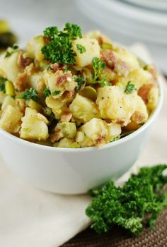 Vinegar-based German Potato Salad with Bacon ~ it's great served both warm or chilled.   www.thekitchenismyplayground.com