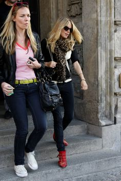 Sienna Miller wearing Louis Vuitton Etole Leopard Scarf, Genetic Denim Jeans, Chanel 2.55 Reissue Flap Bag in Black Patent Leather, Tom Ford Cary T32 Sunglasses and Chloe Flat Studded Boots.